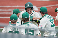 David McCabe (24) of the Charlotte 49ers is congratulated by his teammates after scoring a run during the game against the Old Dominion Monarchs at Hayes Stadium on April 25, 2021 in Charlotte, North Carolina. (Brian Westerholt/Four Seam Images)