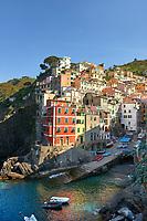 Fishing village and harbour of Riomaggiore at sunrise, Cinque Terre National Park, Liguria, Italy