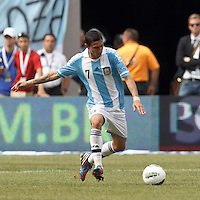 Argentina midfielder Angel Di Maria (7) passes the ball. In an international friendly (Clash of Titans), Argentina defeated Brazil, 4-3, at MetLife Stadium on June 9, 2012.