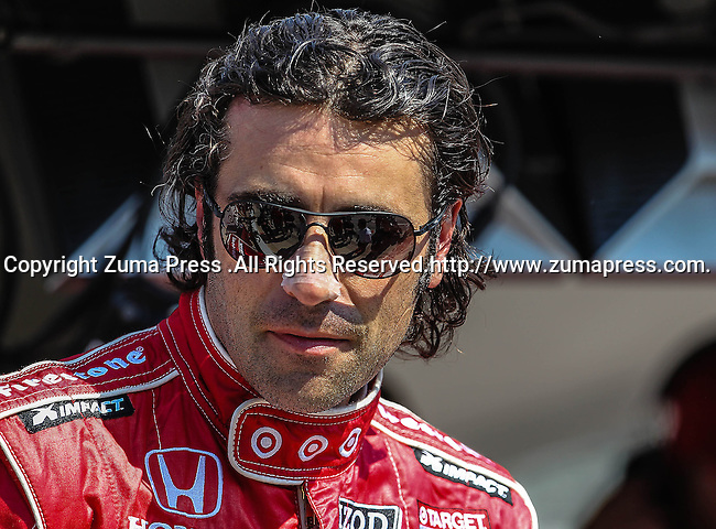 Dario Franchitti (10) driver of the Energizer car in action during qualifying for the IZOD Indycar Firestone 550 race at Texas Motor Speedway in Fort Worth,Texas. IZOD Indycar driver Alex Tagliani (98) driver of the Team Barracuda-BHA car qualifies in the top spot during the Firestone 550 race...