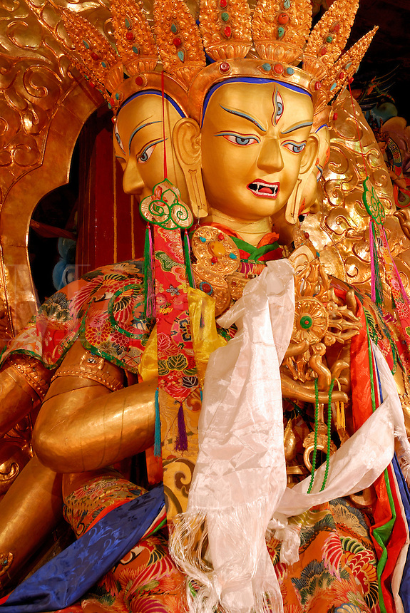 Namgyelma, with three-faces, eight-arms, and ten eyes, holding the nectar of immortality, a peaceful female deity of long life, draped with white silk prayer scarves at Sera Monastery, Lhasa, Tibet, China.