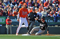 Clemson Tigers third baseman Weston Wilson #8 reacts as Joey Pankake #9 slides in and third base umpire Jacob Asher moves in to declare him safe during a game against the South Carolina Gamecocks at Fluor Field on March 1, 2014 in Greenville, South Carolina. The Gamecocks defeated the Tigers 10-2. (Tony Farlow/Four Seam Images)