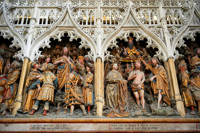 Gothic sculptures depicting scenes from the life of John The Baptist including Christ gbeing baptised. Cathedral of Notre-Dame, Amiens, France.