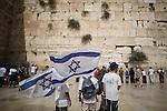 © Joel Goodman - 07973 332324 . 05/06/2016 . Jerusalem , Israel . People wave Israeli flags , sing and dance in front of the Western Wall . Israeli Jews celebrate Jerusalem Day . Photo credit : Joel Goodman