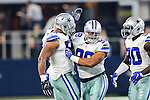 Dallas Cowboys defensive end Jack Crawford (58)and Dallas Cowboys defensive tackle Tyrone Crawford (98) in action during the pre-season game between the Miami Dolphins and the Dallas Cowboys at the AT & T stadium in Arlington, Texas.