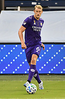 KANSAS CITY, KS - SEPTEMBER 23: Robin Jansson #6 of Orlando City with the ball during a game between Orlando City SC and Sporting Kansas City at Children's Mercy Park on September 23, 2020 in Kansas City, Kansas.