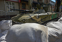 APC taken by Civil army of Donbas seen near office of Security service of Ukraine in Slavyansk city.