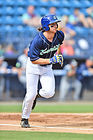 Asheville Tourists shortstop Ryan Vilade (4) runs to first base during game one of a double header against the Columbia Fireflies at McCormick Field on August 4, 2018 in Asheville, North Carolina. The Tourists defeated the Fireflies 5-1. (Tony Farlow/Four Seam Images)