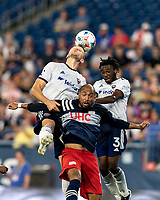 FOXBOROUGH, MA - AUGUST 18: Teal Bunbury #10 of New England Revolution, Steven Birnbaum #15 of D.C. United, and Chris Odoi-Atsem #3 of D.C. United battle for head ball during a game between D.C. United and New England Revolution at Gillette Stadium on August 18, 2021 in Foxborough, Massachusetts.