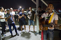 KAZAN, RUSSIA - June 25, 2018: An Iran fan plays a guitar on a train platform before boarding a train to Saransk for the Iran vs. Portugal group stage match at Mordovia Arena during the 2018 FIFA World Cup.