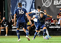 LAKE BUENA VISTA, FL - JULY 26: Graham Zusi of Sporting KC protects the ball from Cristián Gutiérrez of Vancouver Whitecaps FC during a game between Vancouver Whitecaps and Sporting Kansas City at ESPN Wide World of Sports on July 26, 2020 in Lake Buena Vista, Florida.