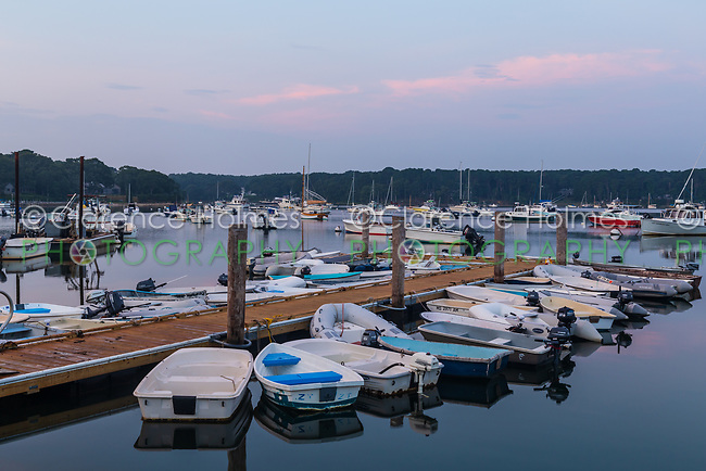Dinghies tied up at Lake Street Landing and boats moored on Lake Tashmoo shortly after sunrise in Tisbury, Massachusetts on Martha's Vineyard.
