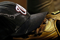8 September 2006: Nationals Cap and Glove - Austin Kearns' cap and glove rest on a dugout step. The Rockies defeated the Nationals 11-8 at Coors Field in Denver, Colorado...Mandatory Photo Credit: Ed Wolfstein.