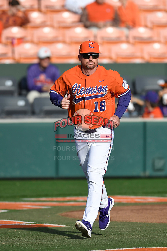Head coach Monte Lee (18) of the Clemson Tigers in a game against the William and Mary Tribe on February 16, 2018, at Doug Kingsmore Stadium in Clemson, South Carolina. Clemson won, 5-4 in 10 innings. (Tom Priddy/Four Seam Images)