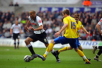 ATTENTION SPORTS PICTURE DESK<br /> Pictured: Darren Pratley of Swansea (L) avoids a tackle by Mark Beecers of Sheffield Wednesday (R)<br /> Re: Coca Cola Championship, Swansea City Football Club v Sheffield Wednesday at the Liberty Stadium, Swansea, south Wales. Saturday 13 Marchy 2010