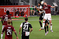 Rodrigo Bentancur of Juventus and Zlatan Ibrahimovic of AC Milan in action during the Serie A football match between AC Milan and Juventus FC at stadio San Siro in Milan ( Italy ), July 7th, 2020. Play resumes behind closed doors following the outbreak of the coronavirus disease. <br /> Photo Federico Tardito / Insidefoto