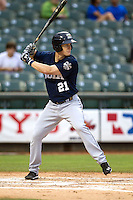 New Orleans Zephyrs first baseman Mark Canha (21) at bat during the Pacific Coast League baseball game against the Round Rock Express on May 27, 2014 at the Dell Diamond in Round Rock, Texas. The Zephyrs defeated the Express 9-0 in a rain shortened game. (Andrew Woolley/Four Seam Images)