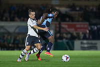 Marcus Bean of Wycombe Wanderers and Kay Voser of Fulham battle for the ball during the Capital One Cup match between Wycombe Wanderers and Fulham at Adams Park, High Wycombe, England on 11 August 2015. Photo by Andy Rowland.