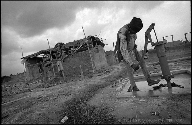 A man washes his feet at a water pump at the Kirin Khola Camp for internally displaced persons (conflict refugees) in Nepal on Saturday, 25 June 2005. Residents of the camp fled violence in the Maoist rebel controlled areas of Nepal.<br />