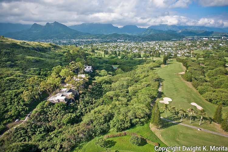 Bluestone Condominiums - Kamahele Street condos on the left and a view down the 17th fairway of the Mid-Pacific Country Club on the right.