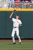 Louisiana State outfielder Mark Laird (9) makes a catch against the North Carolina Tar Heels during Game 7 of the 2013 Men's College World Series on June 18, 2013 at TD Ameritrade Park in Omaha, Nebraska. The Tar Heels defeated the Tigers 4-2, eliminating LSU from the tournament. (Andrew Woolley/Four Seam Images)