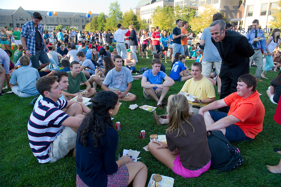August 21, 2012; Rev. John I. Jenkins, C.S.C., president of the University of Notre Dame, chats with a students at a picnic on DeBartolo Quad, following opening Mass. Photo by Barbara Johnston/University of Notre Dame