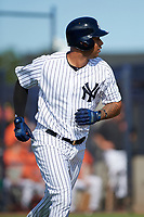 New York Yankees designated hitter Aaron Hicks (31) jogs to first base on an RBI fly out to left field while on a rehab assignment during an Instructional League game against the Baltimore Orioles September 23, 2017 at the Yankees Minor League Complex in Tampa, Florida.  (Mike Janes/Four Seam Images)
