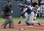 March 30, 2012:   Nevada Wolf Pack catcher Carlos Escobar Jr tags out BYU Cougars Tanner Chauncey as he slides home during their NCAA baseball game played at Peccole Park on Friday afternoon in Reno, Nevada.