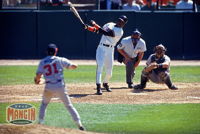 SAN FRANCISCO, CA:  Barry Bonds of the San Francisco Giants bats during a game against Greg Maddux of the Atlanta Braves at Candlestick Park in San Francisco, California on August 25, 1993. (Photo by Brad Mangin)