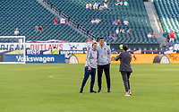 PHILADELPHIA, PA - AUGUST 29: Francisco Neto of Portugal and Jill Ellis of the United States have the their picture taken prior to a game between Portugal and the USWNT at Lincoln Financial Field on August 29, 2019 in Philadelphia, PA.