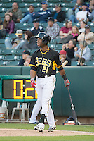 Alfredo Marte (21) of the Salt Lake Bees in action against the Sacramento River Cats in Pacific Coast League action at Smith's Ballpark on April 20, 2015 in Salt Lake City, Utah.  (Stephen Smith/Four Seam Images)