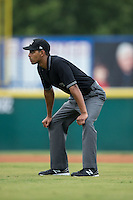 Umpire Ronnie Whiting Jr. handles the calls on the bases during the South Atlantic League game between the West Virginia Power and the Hickory Crawdads at L.P. Frans Stadium on August 15, 2015 in Hickory, North Carolina.  The Power defeated the Crawdads 9-0.  (Brian Westerholt/Four Seam Images)