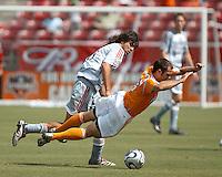 FC Dallas midfielder Juan Toja (8) trips up  Houston Dynamo midfielder Brian Mullan (9).  Houston Dynamo beat FC Dallas 2-1 at Robertson Stadium in Houston, TX on June 3, 2007.