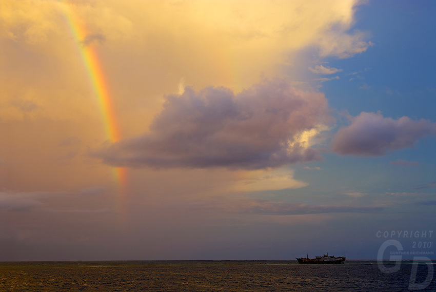 Dramatic sunset and rainbow over a ship wreck on Minto Reef located between Chuuk and Pohnpei Micronesia South Pacific