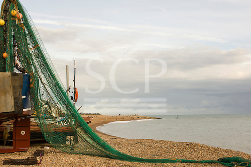 Hastings, East Sussex, England. The fishermen's beach, Rock-a-Nore and green fishing net.