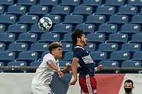 FOXBOROUGH, MA - AUGUST 7: Wilfredo Rivera #62 of Orlando City B and Ryan Spaulding #34 of New England Revolution II battle for head ball during a game between Orlando City B and New England Revolution II at Gillette Stadium on August 7, 2020 in Foxborough, Massachusetts.