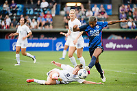 TACOMA, WA - JULY 31: Savannah McCaskill #7 of Racing Louisville FC and Tziarra King #23 of the OL Reign battle for the ball during a game between Racing Louisville FC and OL Reign at Cheney Stadium on July 31, 2021 in Tacoma, Washington.