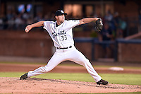 Asheville Tourists pitcher Logan Sawyer (33) delivers a pitch during a game against the Hagerstown Suns at McCormick Field on September 4, 2016 in Asheville, North Carolina. The Suns defeated the Tourists 10-5. (Tony Farlow/Four Seam Images)
