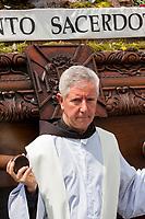 Antigua, Guatemala.  Priest Guiding an Anda (Float) in Easter Sunday Resurrection Procession.  Semana Santa.