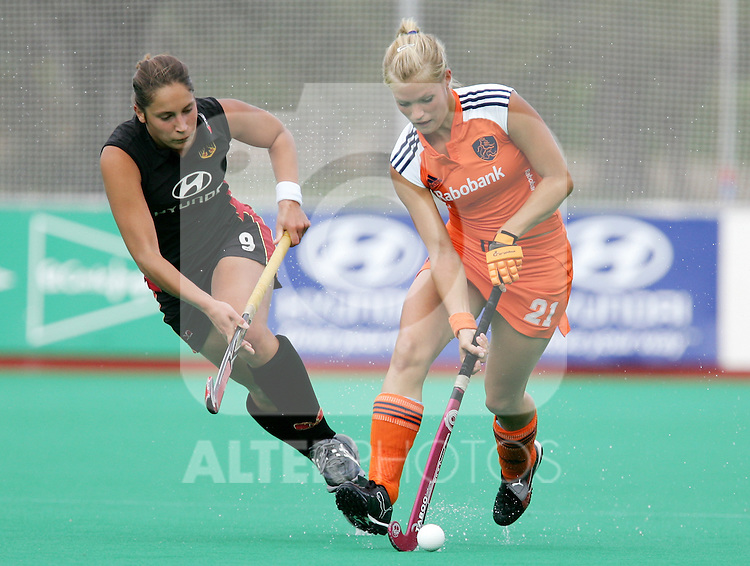 Netherlands' Sophie Polkamp challenged by Germany's Martina Heinlein during Samsung Women's World Cup Hockey Pool A match between Netherlands and Germany at Club de Campo in Madrid, Tuesday 03 October, 2006. (ALTERPHOTOS/Alvaro Hernandez).