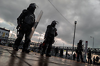 Colombian riot control policemen guard in front of the Universidad Nacional de Colombia during a protest march against government's policies and corruption within the public educational system in Bogotá, Colombia, 24 October 2019.