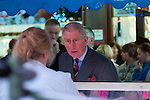 Prince Charles meeting traders and shopper during his visit to Swansea Market in South Wales this afternoon.