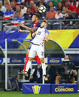 ARLINGTON, TEXAS - Saturday July 22, 2017 Paul Arriola #20 of USMNT defends the ball from Costa Rican National Team in the first have of the match at AT&T Stadium in Arlington, TX