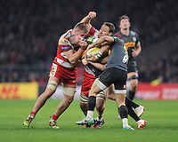 Mike Brown of Harlequins is stopped in his tracks by Ross Moriarty of Gloucester Rugby during the Aviva Premiership Rugby match between Harlequins and Gloucester Rugby at Twickenham Stadium on Tuesday 27th December 2016 (Photo by Rob Munro/Stewart Communications)