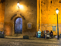 Chefchaouen, Morocco.  Women Sitting, Talking in the Place Outa El-Hammam, Evening, by Entrance to the Casbah, Built 1471.