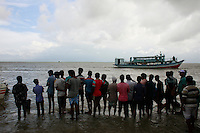 People and relatives stands in the bank of river Padma.  Today the Pinak-6, a passenger vessel sank in the middle of the river Padma on its way to Mawa from Kawrakandi terminal at around 11 PM today. The boat capsized since the river was rough due to the stormy weather. At least 250 people were in the capsized boat. Local people rescued nearly 45 passengers from the river and many other are still missing. Stormy weather and strong current hamper the rescue operation. Mawa, Munshigonj, near Dhaka, Bangladesh