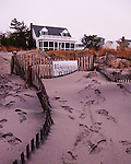 "Sand drifts high in the pathways and across what used to be the boardwalk at Rehoboth Beach, Delaware, USA, in the wake of a major Atlantic northeast storm (""nor'easter"") that arose from the remnants of Hurricane Ida in November, 2009.  The storm brought in exceptionally high tides and waves that flooded many beach communities, but in Rehoboth mainly rearranged the beach sand and dunes."