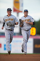 Trenton Thunder outfielders Tyler Austin and Jake Cave (right) jog to the dugout during a game against the Binghamton Mets on August 8, 2015 at NYSEG Stadium in Binghamton, New York.  Trenton defeated Binghamton 4-2.  (Mike Janes/Four Seam Images)