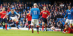 Dean Shiels blasts in a shot which is saved