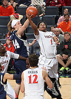 CHARLOTTESVILLE, VA- December 3: Jontel Evans #1 of the Virginia Cavaliers shoots next to Jeff Havenstein #44 of the Longwood Lancers during the game on December 27, 2011 at the John Paul Jones Arena in Charlottesville, Virginia. Virginia defeated Longwood 86-53. (Photo by Andrew Shurtleff/Getty Images) *** Local Caption *** Jeff Havenstein;Jontel Evans